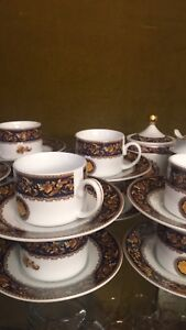 One Tea cups set or coffee and one espresso set Versace mark new