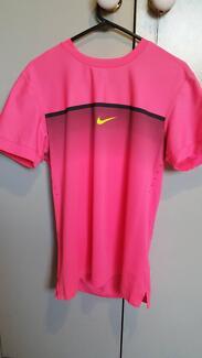 Nike Dri-Fit purple tennis shirt in adult medium size