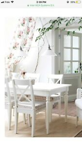 (Price Reduced) IKEA white wood dining table with 4 chairs