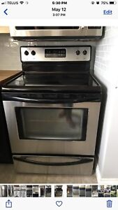 """Frigidaire 30"""" stainless steel electric stove and microwave"""