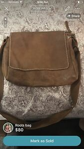 Roots gently used purse