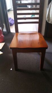 4 stained solid  chairs Airds Campbelltown Area Preview