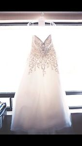 Size 18 wedding dress by Allure with Cathedral vale