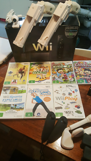 Black Wii with heaps of accessories and games!