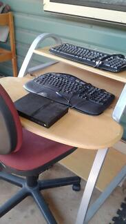 Computer desk, chair, keyboards and a sony playstation