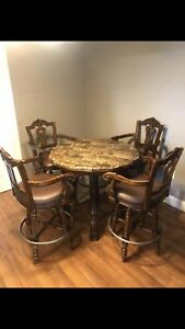 Pub height round marble top wood table 4 leather wood chairs.