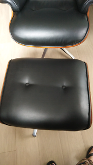 Lounge leather chair with foot rest