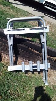 Rod holder/cutting  board