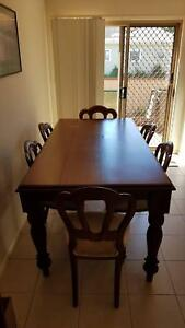 Timber dinning table and chairs