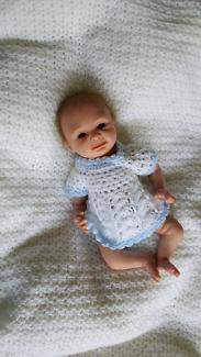 Mini Reborn lifelike baby doll. Approximately 10 inches.