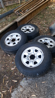 Four steel Hilux wheels with worn tyres