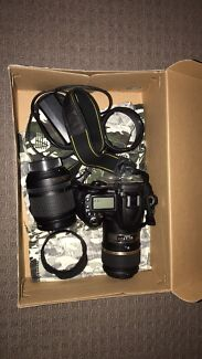 Nikon D90 with 18-105mm and macro lens