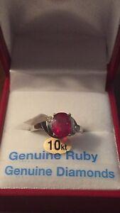 10 KT white gold, Ruby, 2 diamond ring with $1400 appraisal