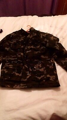 Camouflage Bike Jacket. Good condition. Size XL. Missing one stud on pocket
