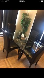 Glass table with 6 chairs for sale or trade