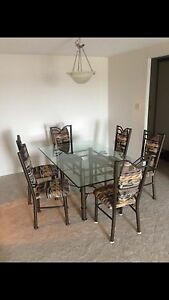 Gorgeous glass top dining table set with 6 chairs