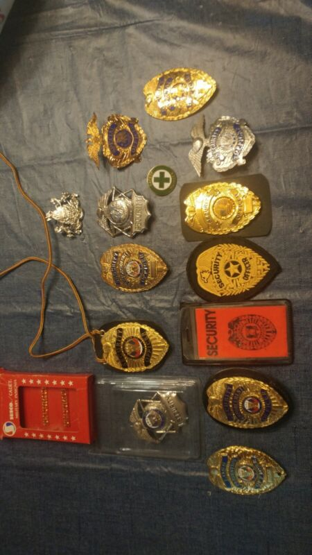 Security enforcement officer badge grouping of 15 badges..