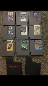 ORIGINAL NIntendo NES systems with games and gun