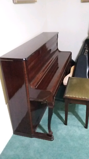 Piano in very good order and piano stool opens to store music