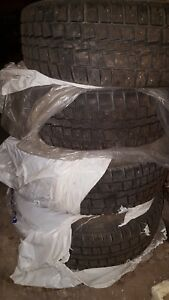 4 Studded winter tires  new price