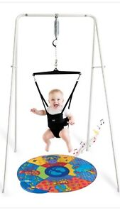 Jolly jumper with a stand and music play mat