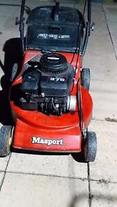 lawnmower working and with catcher