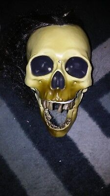Halloween prop GEMMY DROPPING SKULL. Lights, sounds, head goes up and down.
