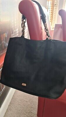 Black, large leather Karl Lagerfeld woman's bag with gold chain details