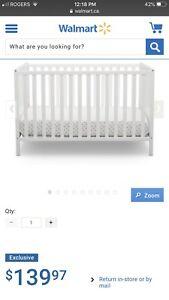 Crib with Waterproof Mattress.