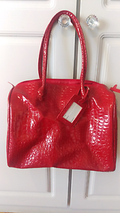 Red faux leather handbag or over night bag Spearwood Cockburn Area Preview