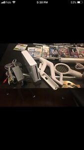 Nintendo wii console with lots of games and accessories.