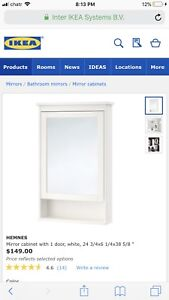 White Ikea hemnes medicine cabinet with mirror and glass shelves