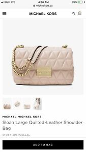Two micheal kors purses