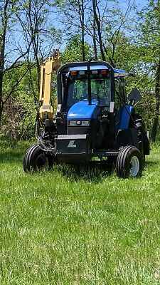 New Holland T100 Farm Tractor With 20 Extendable Boom Brush Cutting Head