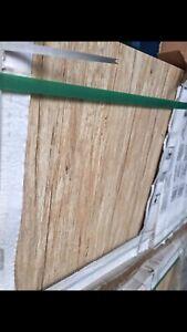 Light hardwood look tiles have 1500 sqft