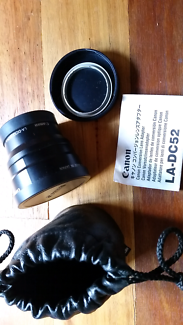 Canon LA-DC52, WC-DC52 0.7x lens and wide convertor.  0.7x