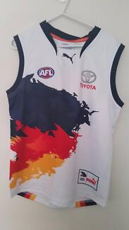 BNWOT Adelaide CROWS genuine replica guernsey.  Size 14 youth.