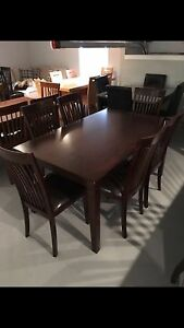 Brand New thick dark brown table and 6 solid chairs only $850