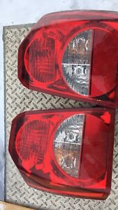 Dodge calibre headlights and taillights asking $100