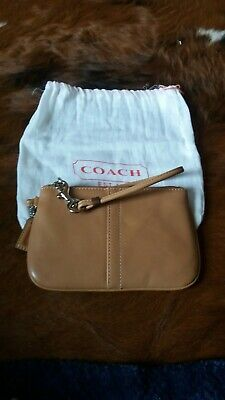 Coach burnished tan leather wristlet with dustbag
