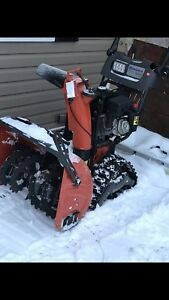 Husqvarna snow blower with Tracks