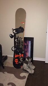 Like new, rossignol snowboard with Salomon snow boots