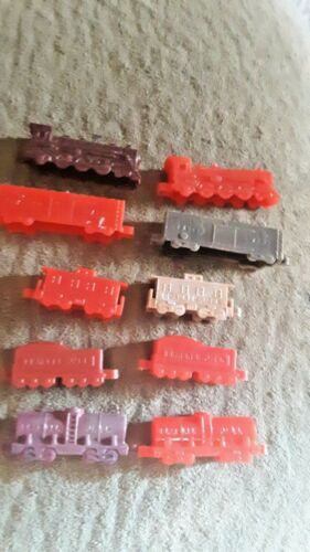 2 Vintage Cracker Jack trains.