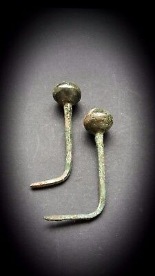 Two Ancient Luristan Bronze Garment Pins with circular finials 2nd Millennium BC