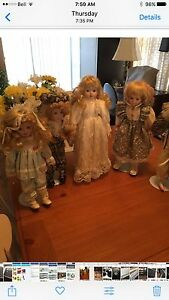 9 PORCELAIN COLLECTABLE DOLLS