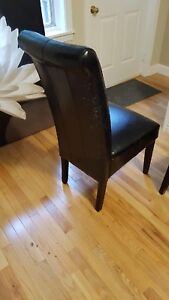 5 leather chairs, leather damaged.