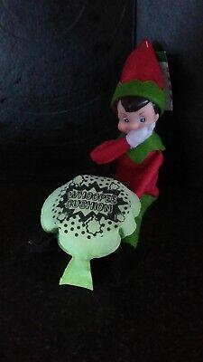 ELF ON A SHELF PROP,  naughty elf brings whoopy cushion. (Whoopy Cushion)