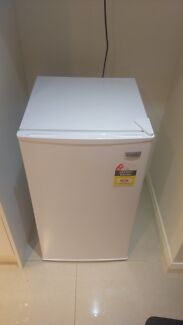 Nearly new fridge with small freezer compartment