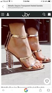Gold strapped sandals with transparent brown glitter heels