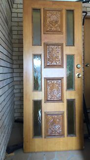 Hand carved timber front door
